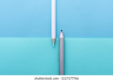 Color pencils and electronic stylus on a background