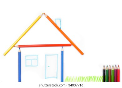 Color pencils formed in the shape of a house. Isolated on white background.