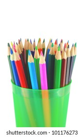 Color pencils in the green prop over white. Shallow DOF.