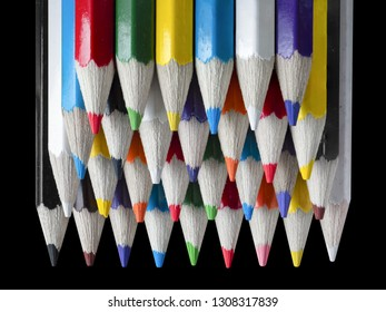Color pencils isolated on black background