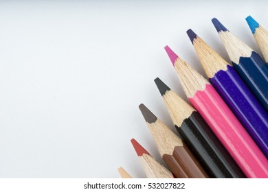 Color pencils isolated on white background for background and education material back to school