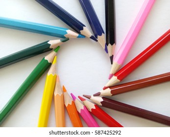 Color pencils isolated on white background.Close up, selective focus, blur image