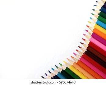 Color pencils isolated on white background. Close up, selective focus, blur image