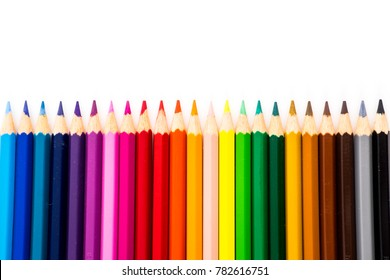 A Color pencils isolated on white background with rainbow style close up.