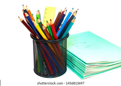 Color pencils and notebooks for school isolated on white
