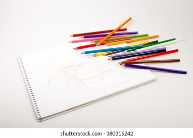 Color pencils and notepad. school concept