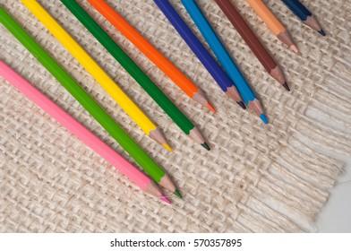 Color pencils on a sackcloth background