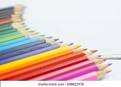 color pencils on white wood table background