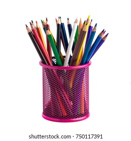 color pencils in the red metal grid container isolated on white with clipping path.
