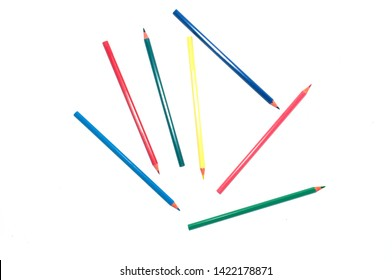 Color pencils scattered on white background top view. Can be used in the concept of education, school, training.