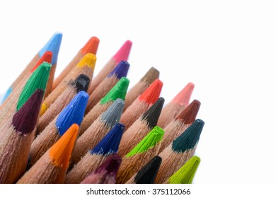 Color pencils of various colors on white background