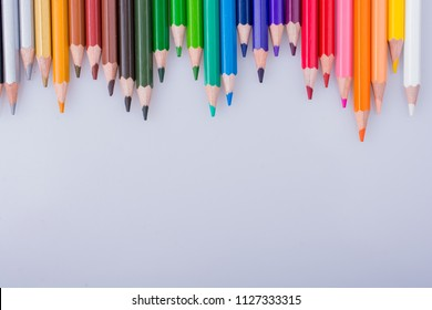 Color Pencils of Various colors placed on white background