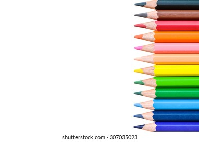 Color pencils with violet, blue, green, yellow, cream, pink, orange, red, brown, black isolated on white background - use for education concept.