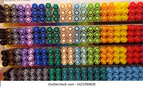 Color pens stored on the shelves make a beautiful art - Shutterstock ID 1421984828