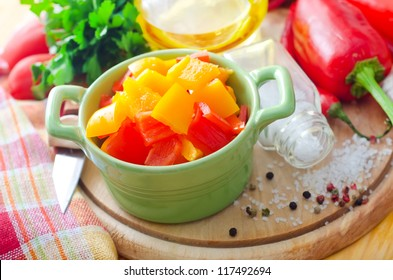 Color peppers on the wooden board, pepper and knife