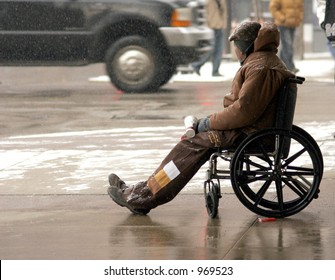 Color Photo of a Homeless Man in a Wheelchair