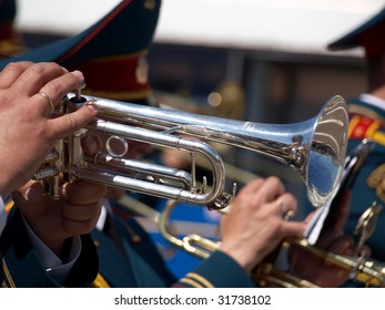 Color photo of a military musician with trumpet