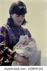 Color photo of a mother and child
