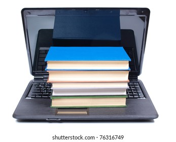 Color photo of an old book and computer