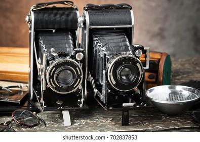 Color photo of an old cameras. Retro still