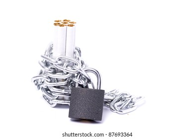 Color photo of pile of cigarettes and a padlock with chain