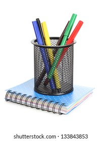Color photo of set of markers in a metal basket