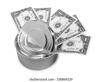 Color photograph of metal cans and paper money