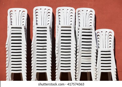 Color photograph of stack-able summer plastic chairs. Created in Andalusia, Spain.