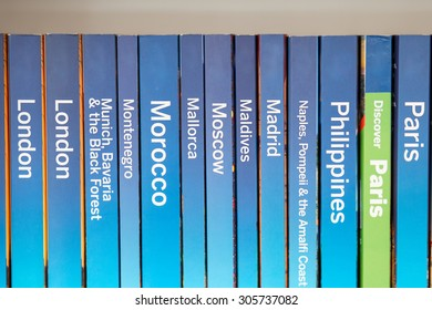 Color picture of guidebooks on a shelf