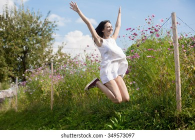 Color picture of a happy woman jumping outdoor