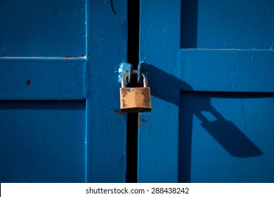 Color picture of a metal lock on a wooden door