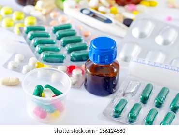 color pills and medical bottle