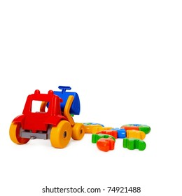 Color plastic toy bulldozer isolated on white background
