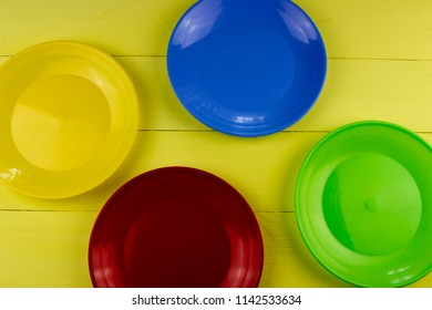 Color plate on a wooden table. Food and kitchen concept. Copy space