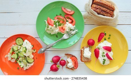 Color plates with cottage cheese with vegetables
