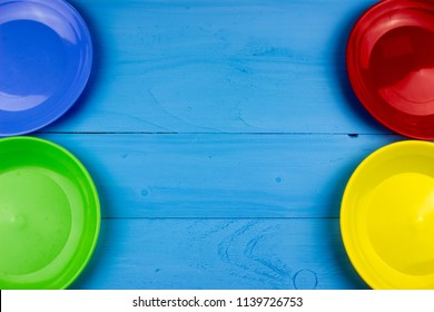 Color plates on a table. Food kitchen and restaurant concept. Empty copy space