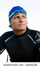 A color portrait of a pensive and determined looking triathlete.