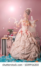Color portrait of woman dressed as Marie Antoinette in pink