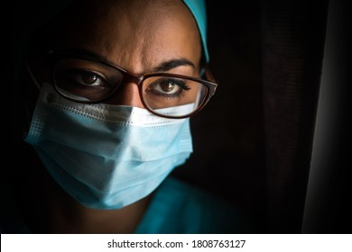 Color portrait of a young female medic, wearing a mask and glasses, illustration for the coronavirus Covid-19 pandemic.