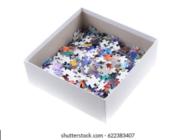 color puzzle in the paper box isolated on the white background