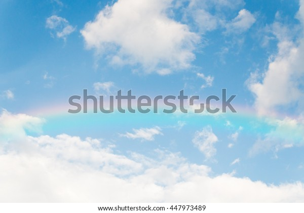 Color rainbow with soft cloud on blue sky background
