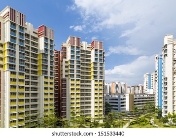 A color residential estate with a park and carpark.