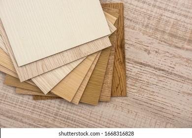 color sample boards for design on wooden desk