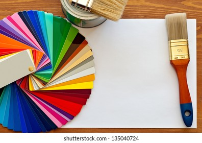 color samples and paint brushes on the wooden table with copy space