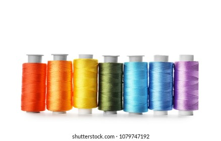 Color sewing threads on white background