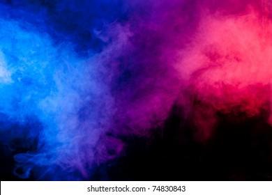 Color smoke on black background