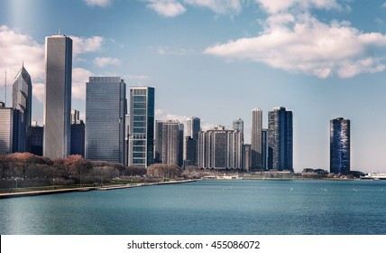 Color snapshot of silhouette of Chicago skyline. Downtown cityscape with skyscrapers. Clear sky daytime on the Michigan lake. Illinois, USA. Vintage tinted.