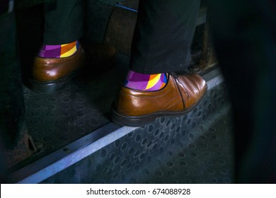 Color socks in brown shoes