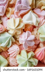 Color sweet homemade meringue and marshmallows