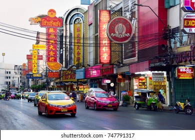 Color taxi rush along the vibrant streets of Chinatown. Street photo. Bangkok. Thailand. February 13, 2017.